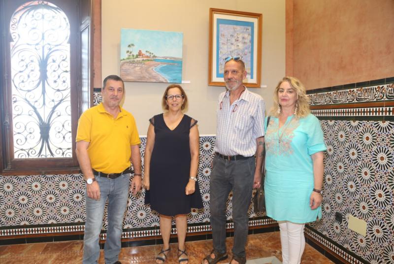 La concejala Elena Galán asiste a la inauguración de la exposición del círculo de pintores solidarios en el castillo del BIL BIL